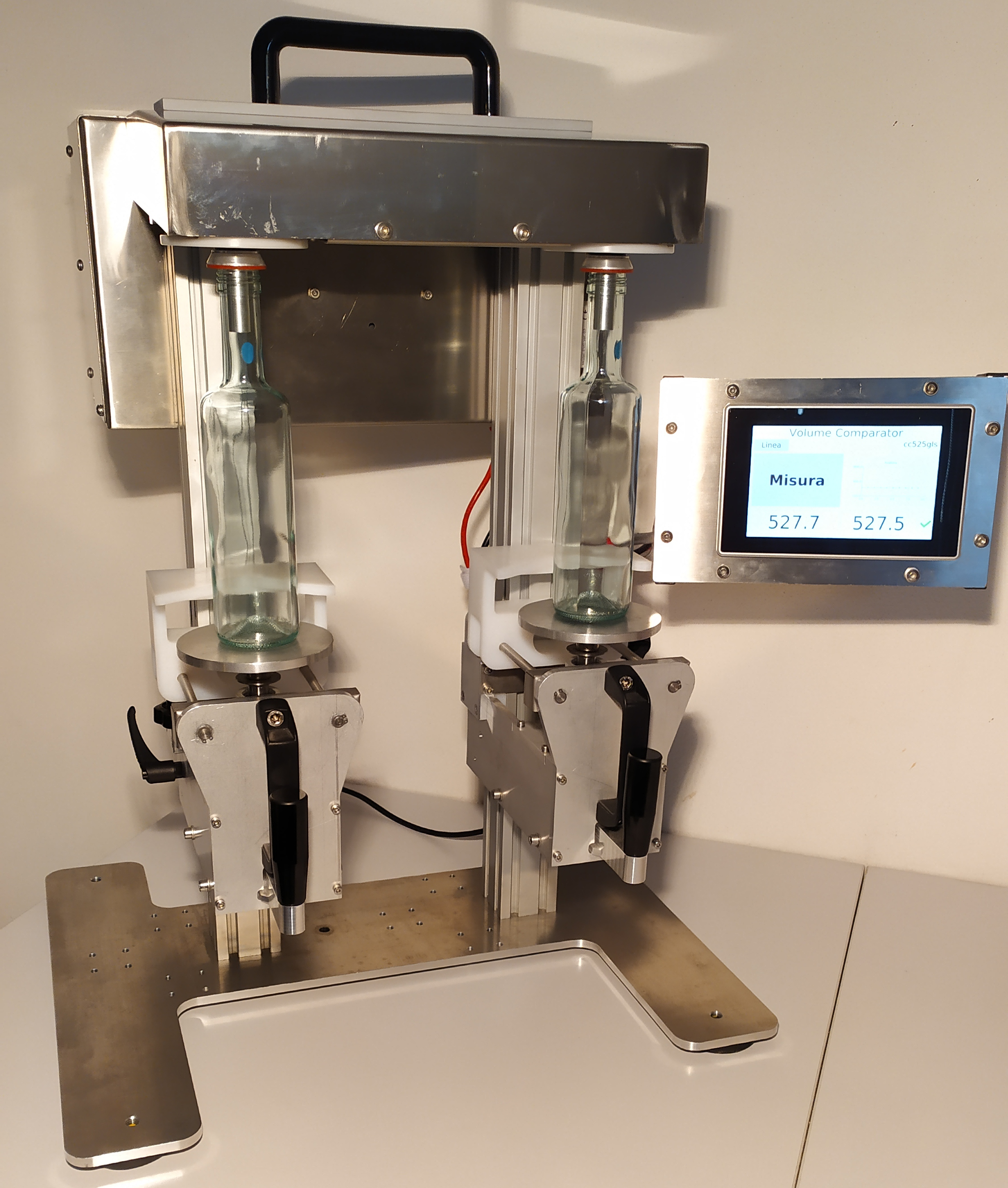 EVC is a machine for measuring the volumes of 							glass containers.
